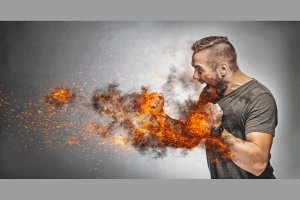 Excited man in fighting gesture with fists on fire. Rage concept. Heated fight. Aggressive behaviour concept Bild: AdobeStock_PhotocreoBednarek