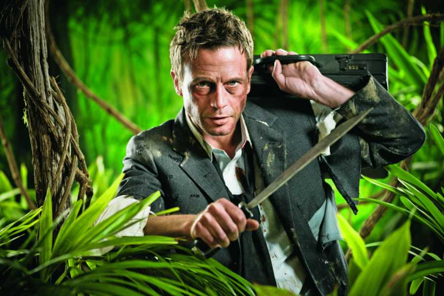 Confident strong businessman dealing with jungle dangers, holding a machete. | Bild: Fotolia_stokkete
